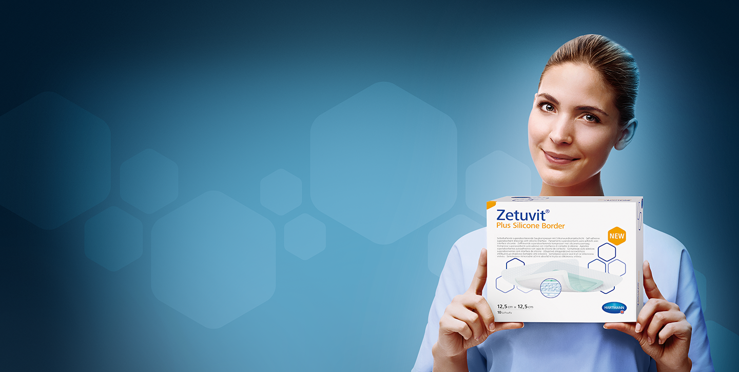 nurse holding zetuvit plus silicone border product